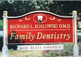 carved sign family denitist